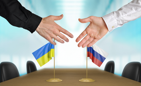 agreeing: Ukraine and Russia diplomats agreeing on a deal