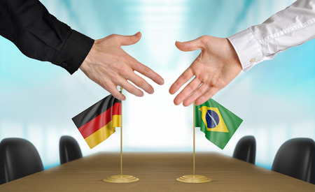 agreeing: Germany and Brazil diplomats agreeing on a deal Stock Photo