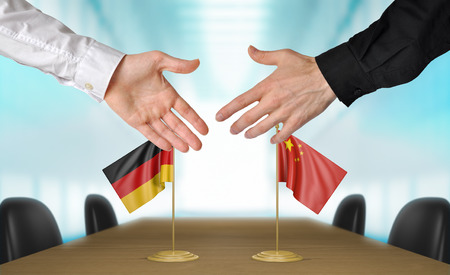agreeing: Germany and China diplomats agreeing on a deal