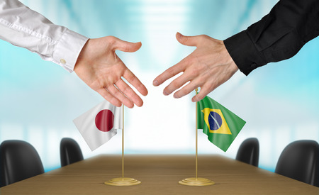 agreeing: Japan and Brazil diplomats agreeing on a deal