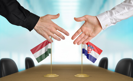 agreeing: Hungary and Croatia diplomats agreeing on a deal