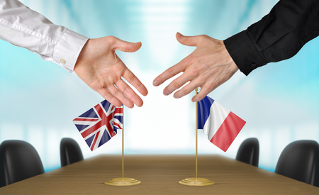agreeing: United Kingdom and France diplomats agreeing on a deal