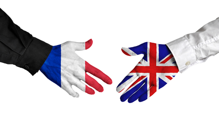 french: France and United Kingdom leaders shaking hands on a deal agreement Stock Photo