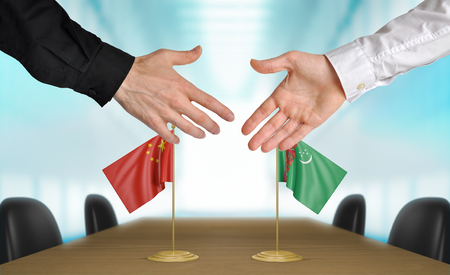 agreeing: China and Turkmenistan diplomats agreeing on a deal