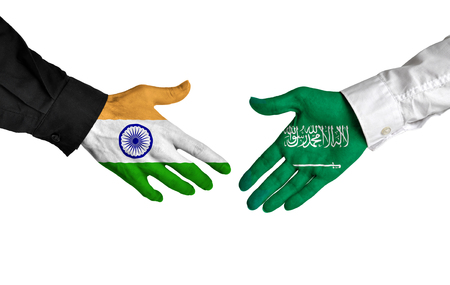 union flag: India and Saudi Arabia leaders shaking hands on a deal agreement Stock Photo