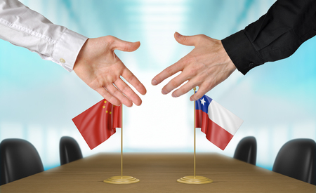 diplomats: China and Chile diplomats agreeing on a deal