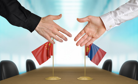 agreeing: China and Mongolia diplomats agreeing on a deal Stock Photo