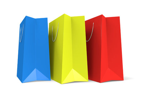 Three paper shopping bags in blue, yellow, and red colors Stock fotó