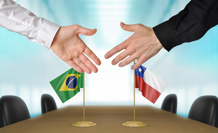 diplomats: Brazil and Chile diplomats agreeing on a deal