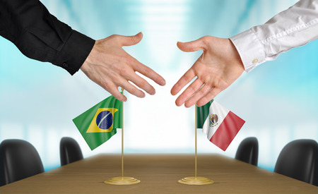 diplomats: Brazil and Mexico diplomats agreeing on a deal Stock Photo