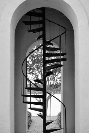 stairwell: Black and white photo of tall metal stairs in a clock tower stairwell