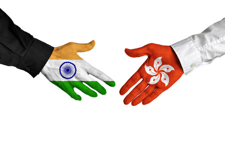 union flag: India and Hong Kong leaders shaking hands on a deal agreement Stock Photo