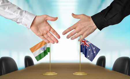 diplomats: India and Australia diplomats agreeing on a deal