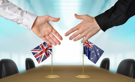 agreeing: United Kingdom and Australia diplomats agreeing on a deal Stock Photo