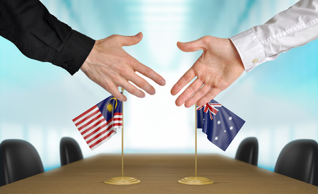 agreeing: Malaysia and Australia diplomats agreeing on a deal