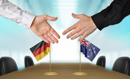 agreeing: Germany and Australia diplomats agreeing on a deal Stock Photo