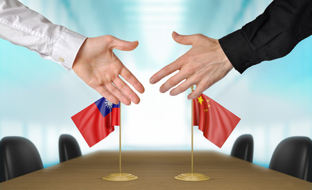 agreeing: Taiwan and China diplomats agreeing on a deal