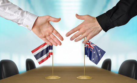agreeing: Thailand and Australia diplomats agreeing on a deal Stock Photo