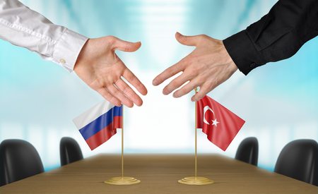 agreeing: Russia and Turkey diplomats agreeing on a deal Stock Photo