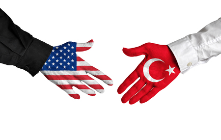 turkish flag: United States and Turkey leaders shaking hands on a deal agreement Stock Photo