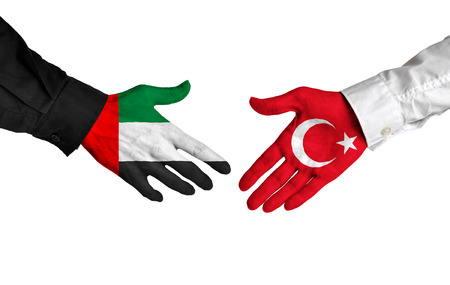 foreign policy: United Arab Emirates and Turkey leaders shaking hands on a deal agreement