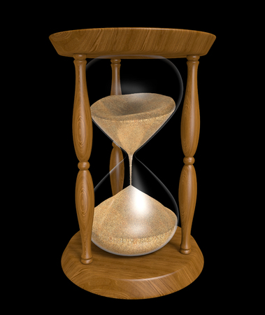 trickling: Sand trickling down an old wood hourglass as time passes
