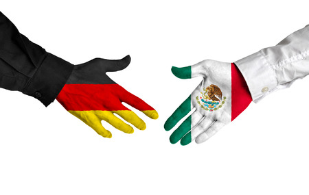 Germany and Mexico leaders shaking hands on a deal agreement Reklamní fotografie
