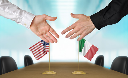 diplomats: United States and Italy diplomats shaking hands to agree deal Stock Photo