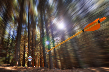 achieve goal: Arrow flying to target with radial motion blur Stock Photo