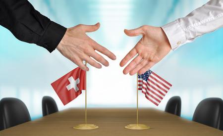 agree: Suiza y Estados Unidos diplomáticos dándose la mano para acordar acuerdo