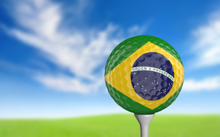 playing golf: Golf ball with Brazil flag colors sitting on a tee