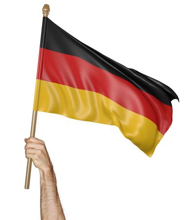 personas saludando: Agitando la mano con orgullo la bandera nacional de Alemania Foto de archivo