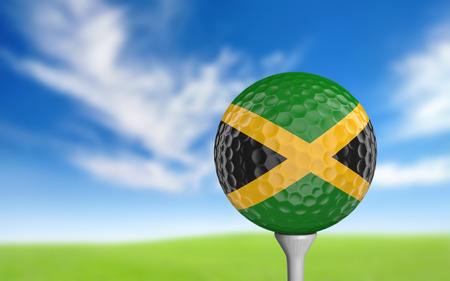 ball game: Golf ball with Jamaica flag colors sitting on a tee
