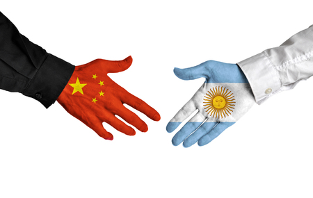 allies: China and Argentina leaders shaking hands on a deal agreement Stock Photo