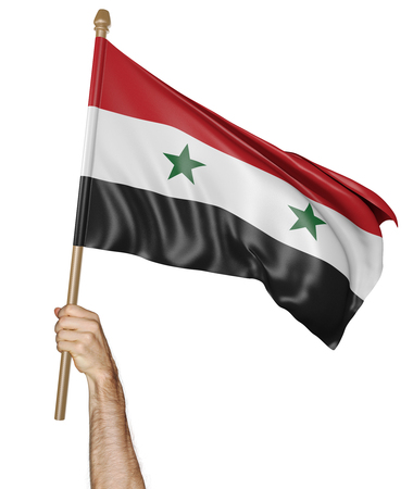 proudly: Hand proudly waving the national flag of Syria