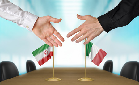 diplomats: Iran and Italy diplomats shaking hands to agree deal Stock Photo