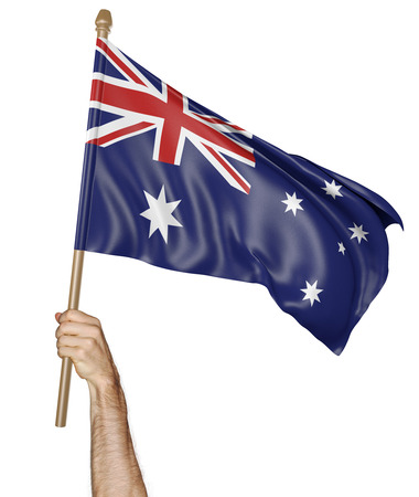 Hand proudly waving the national flag of Australia