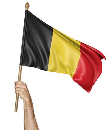 personas saludando: Agitando la mano con orgullo la bandera nacional de Bélgica