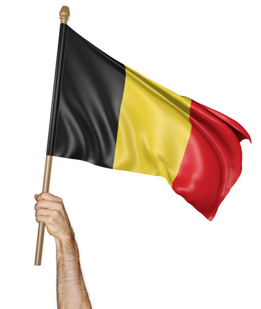 belgium flag: Hand proudly waving the national flag of Belgium