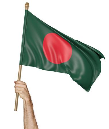 national flag bangladesh: Hand proudly waving the national flag of Bangladesh