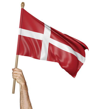 Hand proudly waving the national flag of Denmark