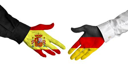 pacto: España y Alemania líderes dándose la mano sobre un acuerdo de reparto