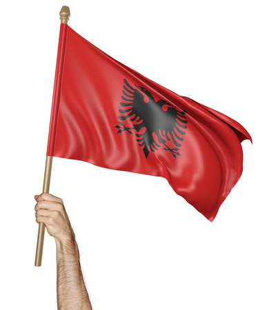 proudly: Hand proudly waving the national flag of Albania Stock Photo