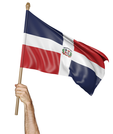 proudly: Hand proudly waving the national flag of the Dominican Republic