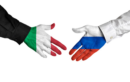 allies: Italy and Russia leaders shaking hands on a deal agreement Stock Photo