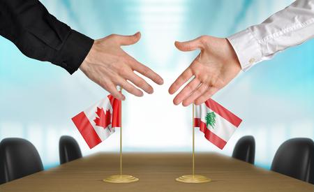 coincidir: Canad� y L�bano diplom�ticos d�ndose la mano para acordar acuerdo Foto de archivo