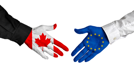 canada country: Canada and European Union leaders shaking hands on a deal agreement