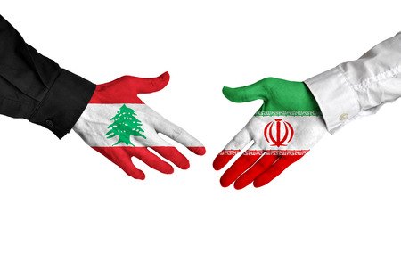 foreign national: Lebanon and Iran leaders shaking hands on a deal agreement