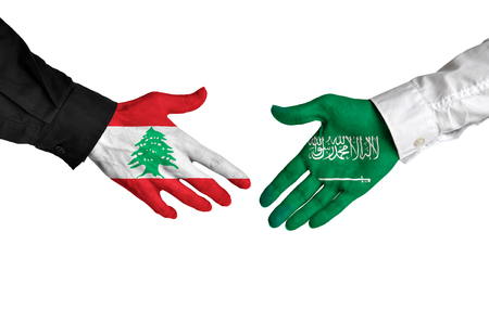 foreign policy: Lebanon and Saudi Arabia leaders shaking hands on a deal agreement Stock Photo