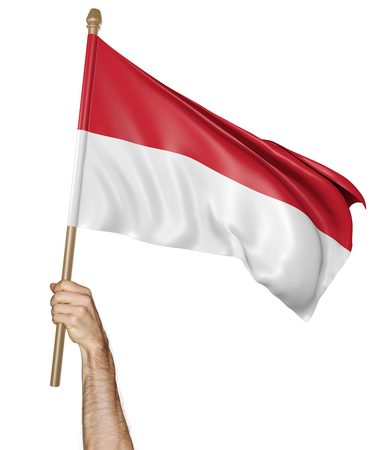 Hand proudly waving the national flag of Indonesia